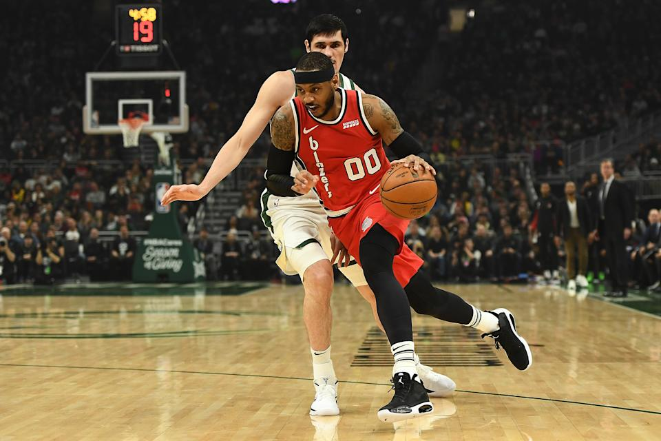 MILWAUKEE, WISCONSIN - NOVEMBER 21: Carmelo Anthony #00 of the Portland Trail Blazers drives around Ersan Ilyasova #7 of the Milwaukee Bucks during the first half of a game at Fiserv Forum on November 21, 2019 in Milwaukee, Wisconsin. NOTE TO USER: User expressly acknowledges and agrees that, by downloading and or using this photograph, User is consenting to the terms and conditions of the Getty Images License Agreement. (Photo by Stacy Revere/Getty Images)