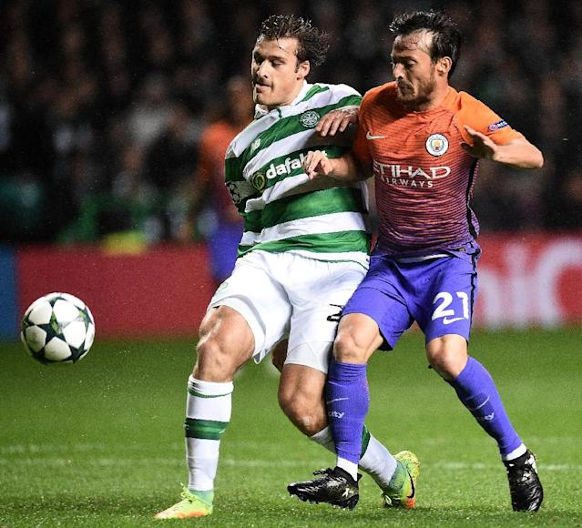 Celtic's Danish defender Erik Sviatchenko (L) vies with Manchester City's Spanish midfielder David Silva during the UEFA Champions League Group C football match between Celtic and Manchester City (AFP Photo/Oli Scarff)