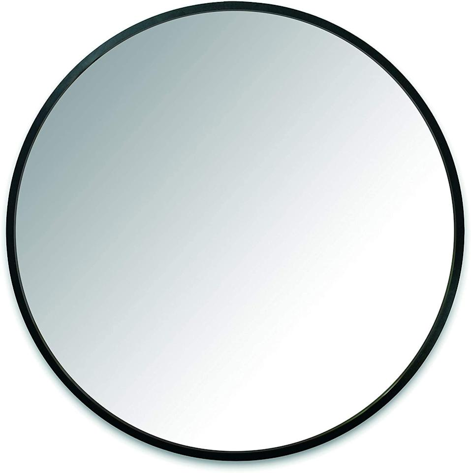 """<p>Hang this <product href=""""https://www.amazon.com/Umbra-Wall-Mirror-Rubber-Frame/dp/B01N6LEAEZ/ref=lp_17552935011_1_3?s=home-garden&amp;ie=UTF8&amp;qid=1596822301&amp;sr=1-3&amp;th=1"""" target=""""_blank"""" class=""""ga-track"""" data-ga-category=""""Related"""" data-ga-label=""""https://www.amazon.com/Umbra-Wall-Mirror-Rubber-Frame/dp/B01N6LEAEZ/ref=lp_17552935011_1_3?s=home-garden&amp;ie=UTF8&amp;qid=1596822301&amp;sr=1-3&amp;th=1"""" data-ga-action=""""In-Line Links"""">Umbra Hub Wall Mirror With Rubber Frame</product> ($100) in your entryway.</p>"""
