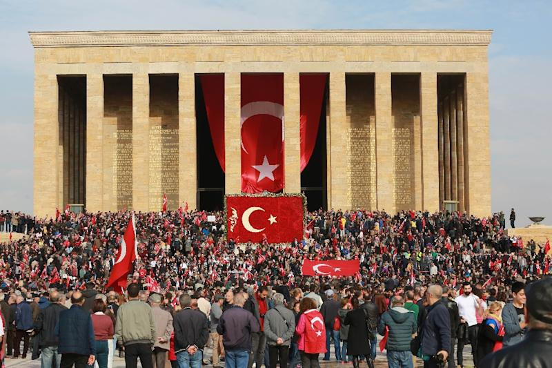 People wave Turkish flags at the Anitkabir, the mausoleum of the founder of Turkish Republic Mustafa Kemal Ataturk, during celebrations marking the 93rd Anniversary of Republic Day in Ankara on October 29, 2016