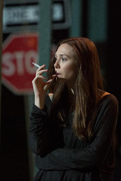 """This image released by FilmDistrict Pictures shows Elizabeth Olsen in a scene from """"Oldboy."""" (AP Photo/FilmDistrict Pictures, Hilary Bronmyn Gayle)"""