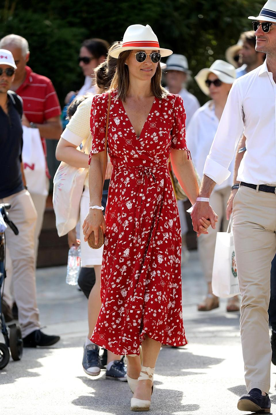 <p>Stepping out at the French Open, Pippa wore a red, printed Ralph Lauren wrap dress with a Roland-Garros fedora hat, Ray-Ban sunnies, heeled Castaner Urban espadrilles and an ultra cute straw, cross-body bag by Boho Bags. <br><em>[Photo: Getty]</em> </p>