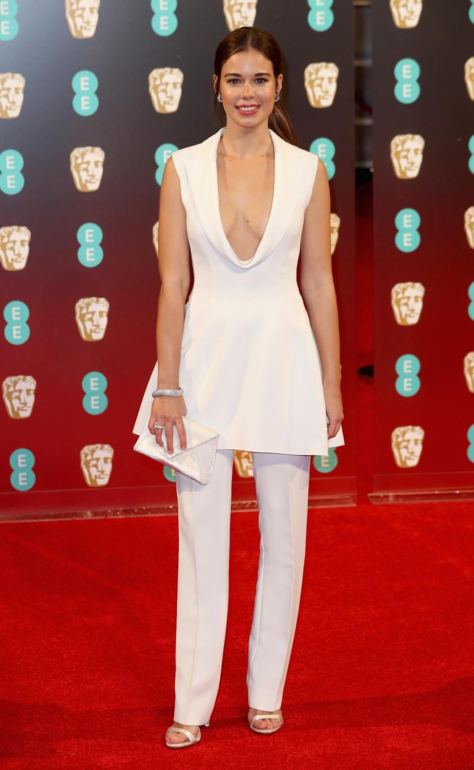 <p>Laila went for a white V-neck and matching straight-legged trousers by Roberto Cavalli. <i>[Photo: Getty]</i> </p>