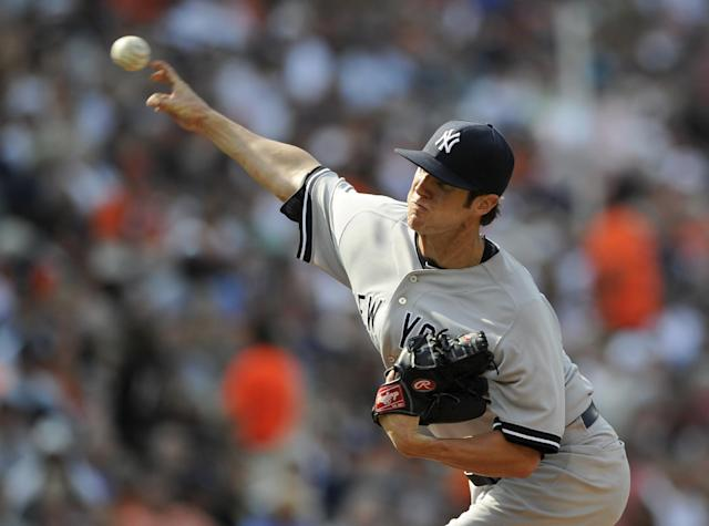 New York Yankees starting pitcher Shane Greene delivers a pitch against the Baltimore Orioles during the third inning of a baseball game, Saturday, July 12, 2014, in Baltimore. (AP Photo/Nick Wass)