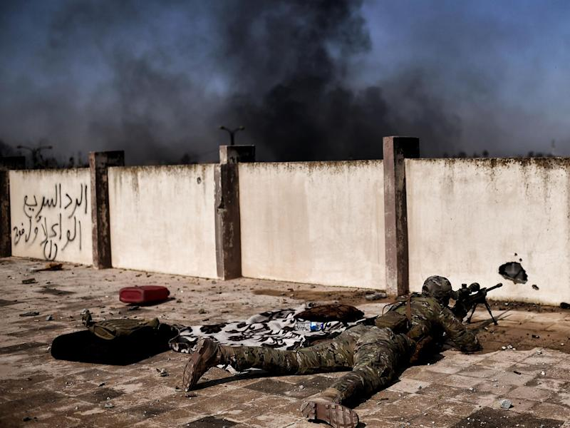 A sniper fires at targets during clashes with Islamic State group fighters in Mosul (file photo): ARIS MESSINIS/AFP/Getty Images