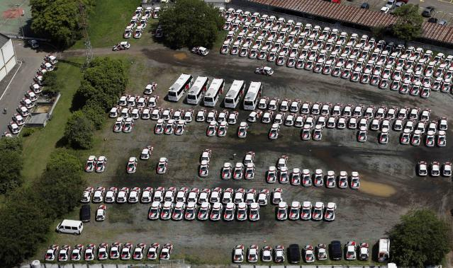 Police cars are pictured in a field in downtown Sao Paulo November 28, 2013. REUTERS/Paulo Whitaker (BRAZIL - Tags: CRIME LAW SOCIETY)