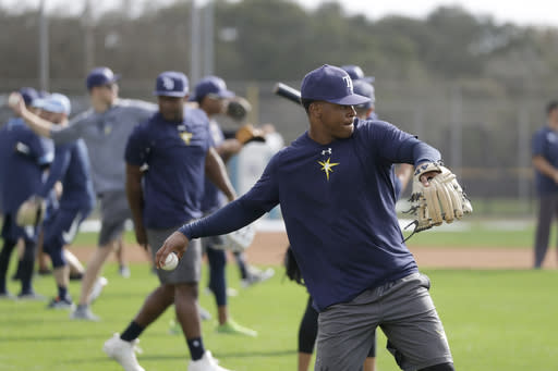 FILE - Tampa Bay Rays pitchers and catchers throw after reporting for spring training baseball camp in Port Charlotte, Fla., in this Wednesday, Feb. 12, 2020, file photo. Big league managers say that Major League Baseball has instructed them to prepare for spring training to start on time in mid-February despite uncertainty around the coronavirus. Tampa Bay Rays manager Kevin Cash said Wednesday, Dec. 16, 2020, that officials from the commissioner's office had a meeting with managers Tuesday an expressed optimism about opening spring camps as scheduled. (AP Photo/John Bazemore, File)