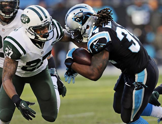 Carolina Panthers' DeAngelo Williams, right, is hit by New York Jets' Dee Milliner (27) during the first half of an NFL football game in Charlotte, N.C., Sunday, Dec. 15, 2013. (AP Photo/Chuck Burton)