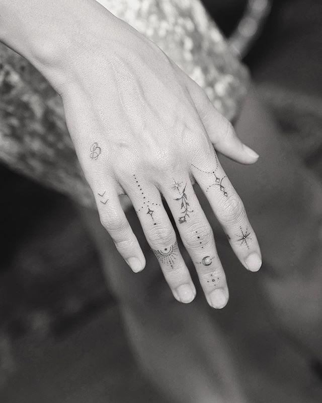"<p>Hailey Baldwin's right hand looks SO different now that she added some fun little tattoos. While she's had the small arrows on her pinky for a while, she just added a couple more things like a star, a flower, and some other small things to make it look like she's wearing some fun jewelry thanks to her new ink. Another big addition is a cute little letter ""B,"" like a nod to Baldwin and Bieber!</p><p><a href=""https://www.instagram.com/p/B1hbZC1nf_1/"" rel=""nofollow noopener"" target=""_blank"" data-ylk=""slk:See the original post on Instagram"" class=""link rapid-noclick-resp"">See the original post on Instagram</a></p>"