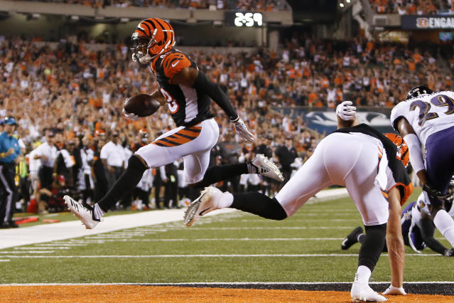 Cincinnati Bengals wide receiver Tyler Boyd (83) leaps in for a touchdown in the first half of an NFL football game against the Baltimore Ravens, Thursday, Sept. 13, 2018, in Cincinnati. (AP Photo/Frank Victores)