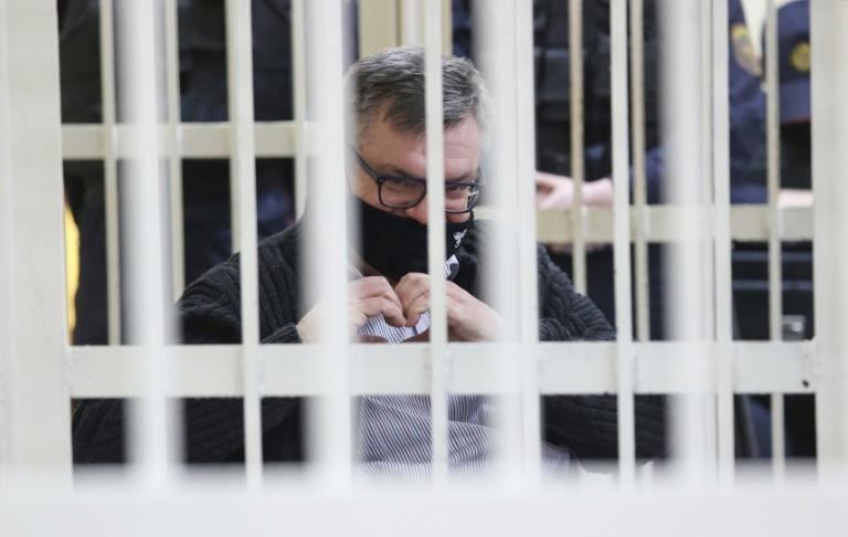 Babaryko appeared in court behind white bars in a cage for defendants and was photographed joining his hands to form the heart symbol popular at protests last year