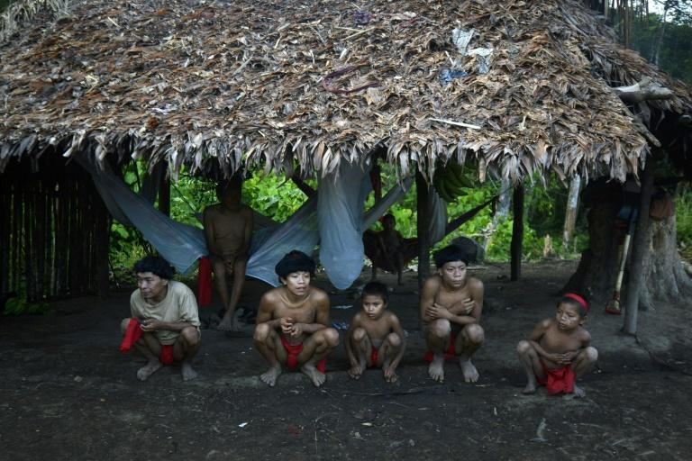 Yanomami natives in a hut in Amazonas state, southern Venezuela, 19 km away from the border with Brazil, on September 7, 2012 (AFP Photo/LEO RAMIREZ)