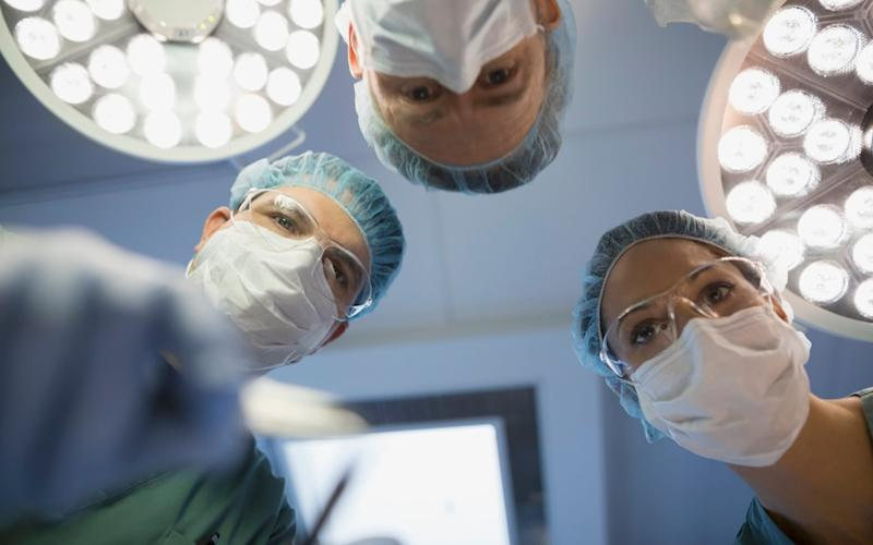 Keyhole surgery, where an operation is carried out through a small hole in the patient's body, has become increasingly common because it helps patients recover more quickly - Getty Images Contributor