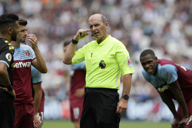Referee Mike Dean waits for a VAR decision on the penalty kick, which was given (AP Photo/Kirsty Wigglesworth)