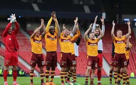 The consensus was that Motherwell and Aberdeen were playing merely for the right to lose to Celtic in the William Hill Scottish Cup final, but there was professional pride at stake at Hampden Park and by the end it belonged to the Steelmen. Stephen Robinson's players ran Aberdeen off the ball, hustled them into horrible errors and punished the Dons with three goals, the recollection of which will awaken Derek McInnes in a cold sweat at dead of night. Aberdeen were runners-up in all three domestic competitions last season but have regressed this campaign, with only the possibility of a second-place league finish remaining. Curtis Main exemplified Motherwell's spirit and desire in this semi-final, scoring in each half and also hunting the Aberdeen defenders deep inside their own territory with a man-of-the-match performance. The man from South Shields has banished the Fir Park fans' regret for the departure of Louis Moult to Preston in January. Both managers had to reshuffle their personnel but Motherwell fared better from the switches. Stephen Robinson restored Allan Campbell to midfield after missing the 0-0 draw at St Johnstone, with Gael Bigirimana relegated to the bench. Chris Cadden, Andy Rose and Charles Dunne replaced Elliott Frear, Barry Maguire and Carl McHugh. Motherwell players aplaude their fans Credit: PA Motherwell's morale had been further boosted by Dunne, Ryan Bowman, Cedric Kipre and Richard Tait all agreeing contract extensions. Aberdeen also made four changes from the team beaten 2-0 by Hearts at Tynecastle, with Chidi Nwakali back from injury and Adam Rooney, Dominic Ball and Kari Arnason in for Graeme Shinnie, Shay Logan and Kenny McLean, with Niall McGinn dropping to the bench. One of the discussion points during the build-up was whether Motherwell would attempt to impose themselves physically, a proposition that took less than 20 seconds to be endorsed as Andrew Rose clattered into Greg Stewart to concede the first foul. Subtlety was exiled fr