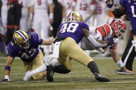 Utah quarterback Jake Bentley, right, dives for extra yardage as he is tackled by Washington linebacker Edefuan Ulofoshio (48) on a keeper play during the first half of an NCAA college football game, Saturday, Nov. 28, 2020, in Seattle. (AP Photo/Ted S. Warren)