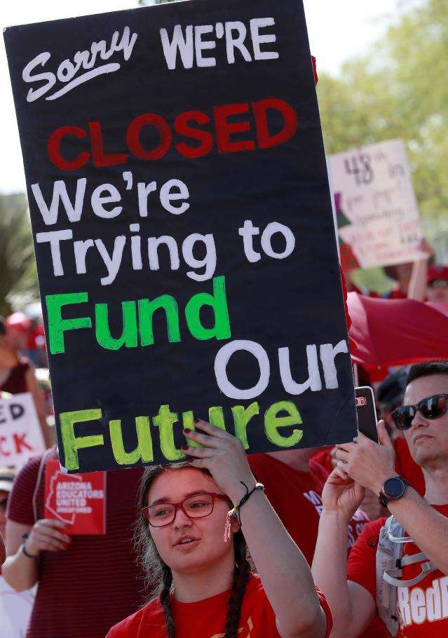 <p>Teachers rally outside the Capitol, Friday, April 27, 2018, in Phoenix, Ariz., on their second day of walkouts. (Photo: Matt York/AP) </p>