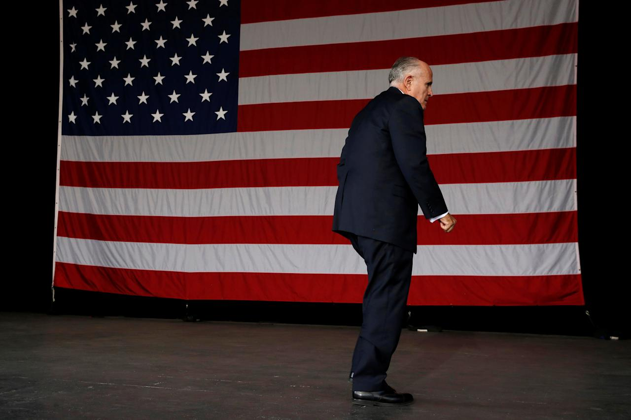 Former New York mayor Rudy Giuliani leaves the stage after speaking at a rally with Republican U.S. presidential nominee Donald Trump in St. Augustine, Florida, U.S. October 24, 2016. REUTERS/Jonathan Ernst