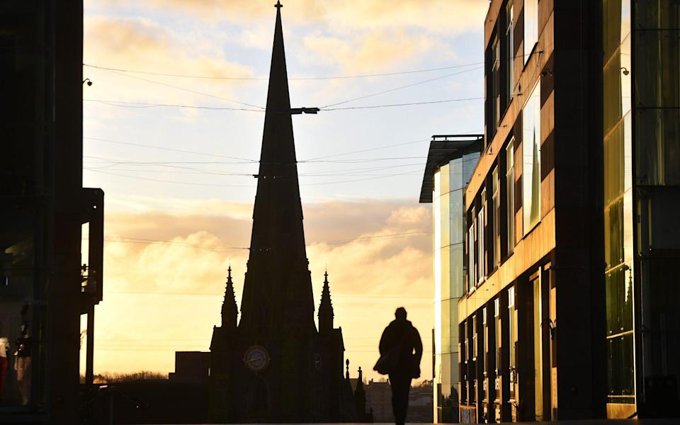 A man walks past St Martins Church in Birmingham during the nationwide lockdown -  Nathan Stirk/Getty
