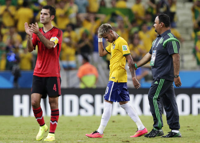 Mexico's Rafael Marquez, left, applauds as Brazil's Neymar walks off the pitch following their 0-0 tie during the group A World Cup soccer match between Brazil and Mexico at the Arena Castelao in Fortaleza, Brazil, Tuesday, June 17, 2014. (AP Photo/Marcio Jose Sanchez)