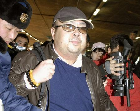 Kim Jong Nam arrives at Beijing airport in Beijing, China, in this photo taken by Kyodo