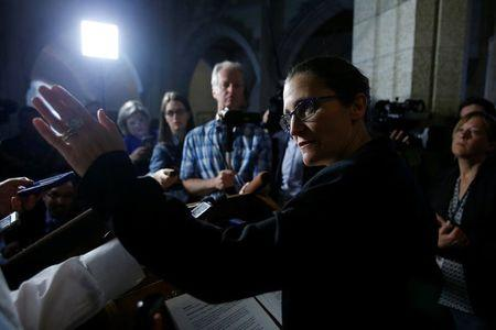 Canada's Foreign Minister Chrystia Freeland speaks to journalists on Parliament Hill in Ottawa