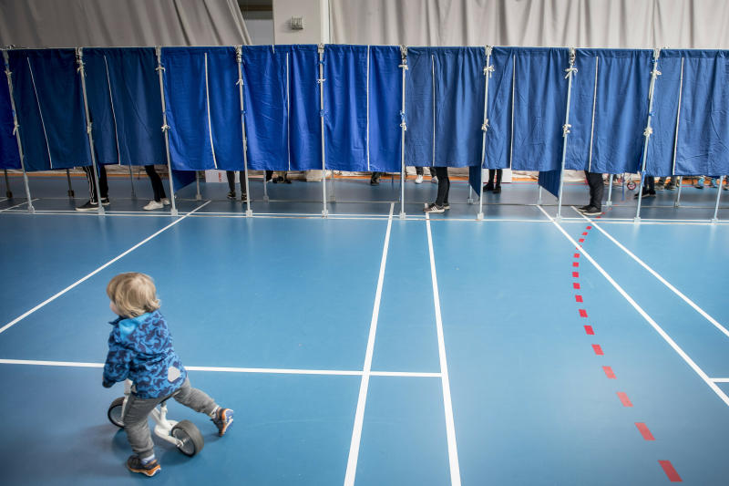 People vote at the Groendal Center in Copenhagen during the European Parliament elections 2019, Sunday May 26, 2019.(Mads Claus Rasmussen/Ritzau Scanpix via AP)