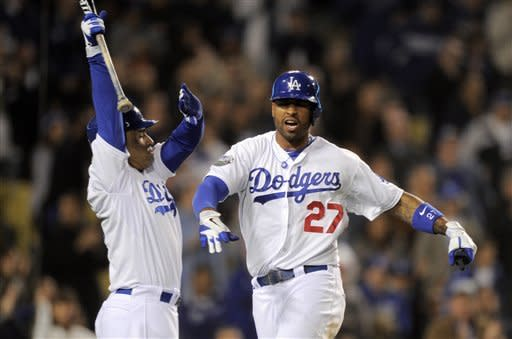 Los Angeles Dodgers' Matt Kemp, right, is congratulated by Jerry Hairston Jr. after scoring on a single by Andre Ethier during the sixth inning of a baseball game against the Pittsburgh Pirates, Wednesday, April 11, 2012, in Los Angeles. (AP Photo/Mark J. Terrill)