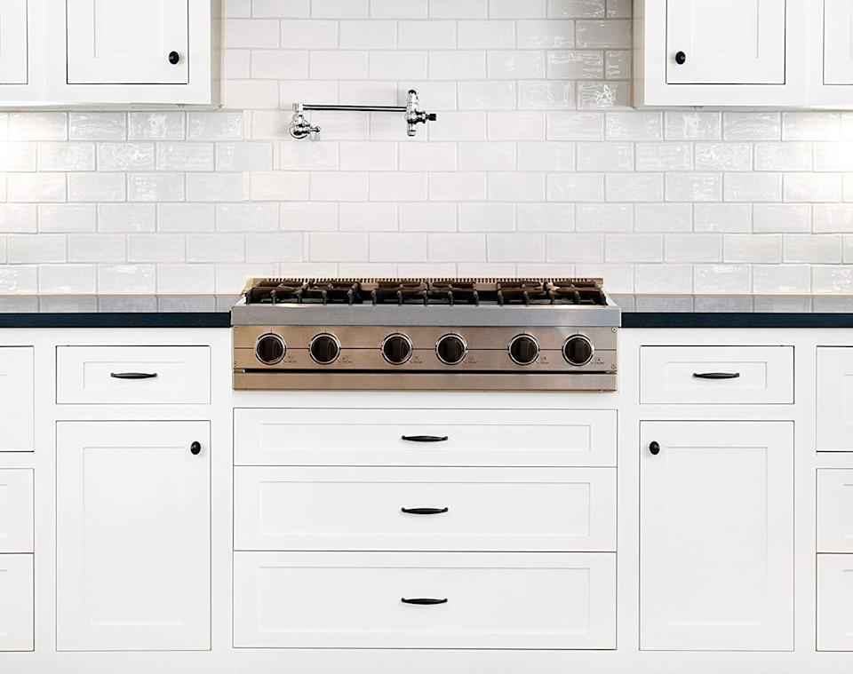 """Of course you're sick of looking at tired, brown drawers in your kitchen. The kit doesn't even require stripping, priming, a top coat or sealer, and there's no need to remove your cabinet doors.It comes with two cans of cabinet paint, a roller arm, two roller covers and an angled paint brush.<br /><br /><strong>Promising review:</strong>""""Amazing! Amazing! Amazing. Did take more than one coat though. My cabinets were bare wood and I still needed a couple of coats. (Five to be exact, but that was just me being extra.) My kitchen is medium-sized, not too big, and it only took up one can. But I still went over a couple more times just to get a nice coating. I also let it sit for some days and saw the wood was sucking up the paint in some areas so I went over it again. The project ideally does take one day like the promotion video says, but one day as in 24 hours.<strong>This took my kitchen from looking like a cheap rental apartment kitchen to a high-quality kitchen with just this paint and new knobs. The paint is perfect for cabinets — it's not too thick, so you still see the wood grains.</strong>It comes with EVERYTHING you need. I didn't have to buy a thing. The project is super easy, paint dries fast, and I did it at first by removing the cabinets but it wasn't necessary at all. Just make sure you don't leave any dripping because it would make your cabinets look cheap. I would recommend EVERYONE to purchase this and give your cabinets a chance before making a big investment in new cabinets. Wood is wood and it can be refinished."""" —<a href=""""https://amzn.to/3v1I4bj"""" target=""""_blank"""" rel=""""nofollow noopener noreferrer"""" data-skimlinks-tracking=""""5723569"""" data-vars-affiliate=""""Amazon"""" data-vars-href=""""https://www.amazon.com/gp/customer-reviews/R6FN0BCK9T85F?tag=bfjasmin-20&ascsubtag=5723569%2C4%2C31%2Cmobile_web%2C0%2C0%2C14870744"""" data-vars-keywords=""""cleaning"""" data-vars-link-id=""""14870744"""" data-vars-price="""""""" data-vars-product-id=""""15955897"""" data-vars-retailers=""""Amazon"""">Brandon"""