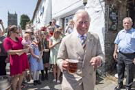 <p>Prince Charles drinks a pint as he and Camilla, Duchess of Cornwall, visit the Duke of York Public House in Devon to join author Sir Michael Morpurgo at a lunch during day three of their visit to Devon and Cornwall on July 21 in Iddesleigh, England.</p>
