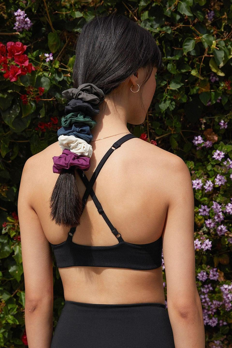 """<p>I'm someone who works out frequently, and the two essentials I need for any great sweat session are a supportive sports bra and a great hair tie. I don't want a regular rubber band because it bends my hair and just isn't a great way to preserve my hair's health, but all the scrunchies I've tried never seem to stay put. That is, until I tried the <span>Girlfriend Collective Scrunchies</span> ($6). It's tight enough to survive my toughest workouts, but there are no bumps or bends in my hair. Plus, the fabric is moisture-wicking, which is perfect for a sweat session. After searching for what feels like forever, I found my perfect hair tie, and if you're as active as I am, you need one too."""" - IY</p> <p>Read the full <a href=""""https://www.popsugar.com/fitness/girlfriend-collective-scrunchie-review-47748860"""" class=""""link rapid-noclick-resp"""" rel=""""nofollow noopener"""" target=""""_blank"""" data-ylk=""""slk:Girlfriend Collective Scrunchie review"""">Girlfriend Collective Scrunchie review</a>.</p>"""