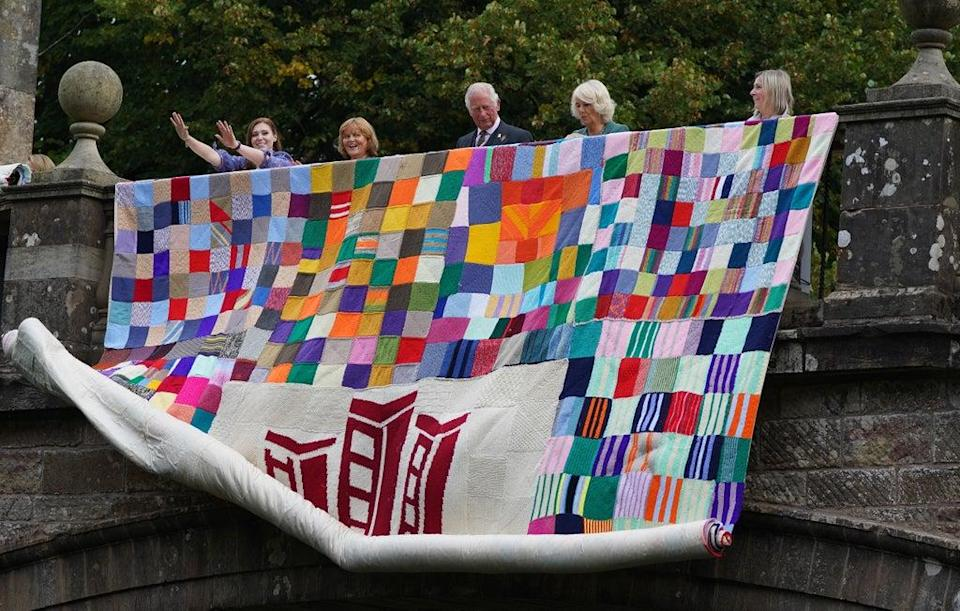 Charles and Camilla, known as the Duke and Duchess of Rothesay when in Scotland, help reveal the knitted art installation (Andrew Milligan/PA) (PA Wire)
