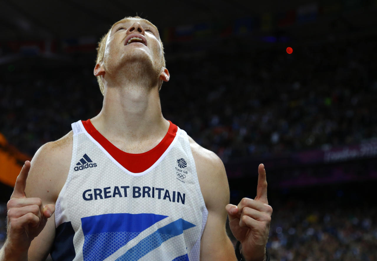 Britain's Greg Rutherford reacts after winning the gold in the men's long jump final at the London 2012 Olympic Games at the Olympic Stadium August 4, 2012.   REUTERS/Phil Noble (BRITAIN  - Tags: OLYMPICS SPORT ATHLETICS TPX IMAGES OF THE DAY)