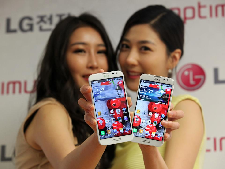 <p> Models pose with LG Electronics' new smartphone Optimus G Pro during a press conference in Seoul, South Korea, Monday, Feb. 18, 2013. LG Electronics Inc. said its Optimus G Pro smartphone with a full high-definition screen will go on sale in South Korea this week and hit shelves in Japan in April. (AP Photo/Ahn Young-joon) </p>