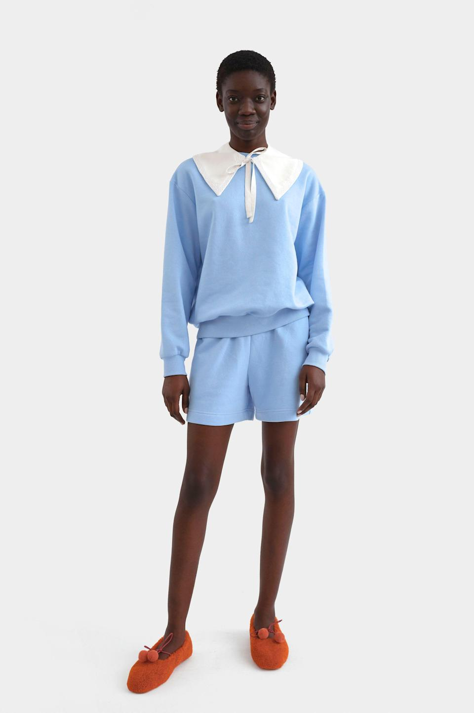 """<p>the-sleeper.com</p><p><strong>$220.00</strong></p><p><a href=""""https://the-sleeper.com/en/product/diana-athpleasure-sweatsuit-with-shorts-in-blue/"""" rel=""""nofollow noopener"""" target=""""_blank"""" data-ylk=""""slk:Shop Now"""" class=""""link rapid-noclick-resp"""">Shop Now</a></p><p>""""Summer's end, for me, is mostly bitter—but the sartorial opportunities that come with cooler weather makes it slightly more sweet. I recently ordered this matching """"Diana"""" set from Sleeper, which comes with a detachable cotton collar (!!) and endless styling opportunities: layered over an oversized striped button down, dressed up with bold jewelry and heels, or worn as is, perhaps with sneakers and a hat.""""—<em>Lucia Tonelli, Associate Editor</em></p>"""