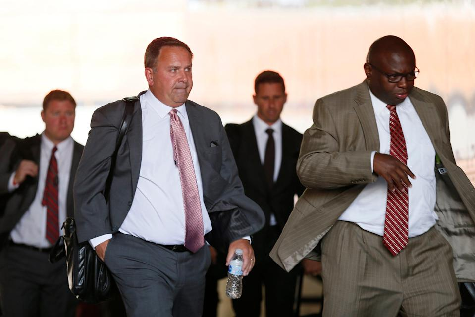 Ohio State assistant coaches Kevin Wilson, left, and Tony Alford on Aug. 31, 2017.
