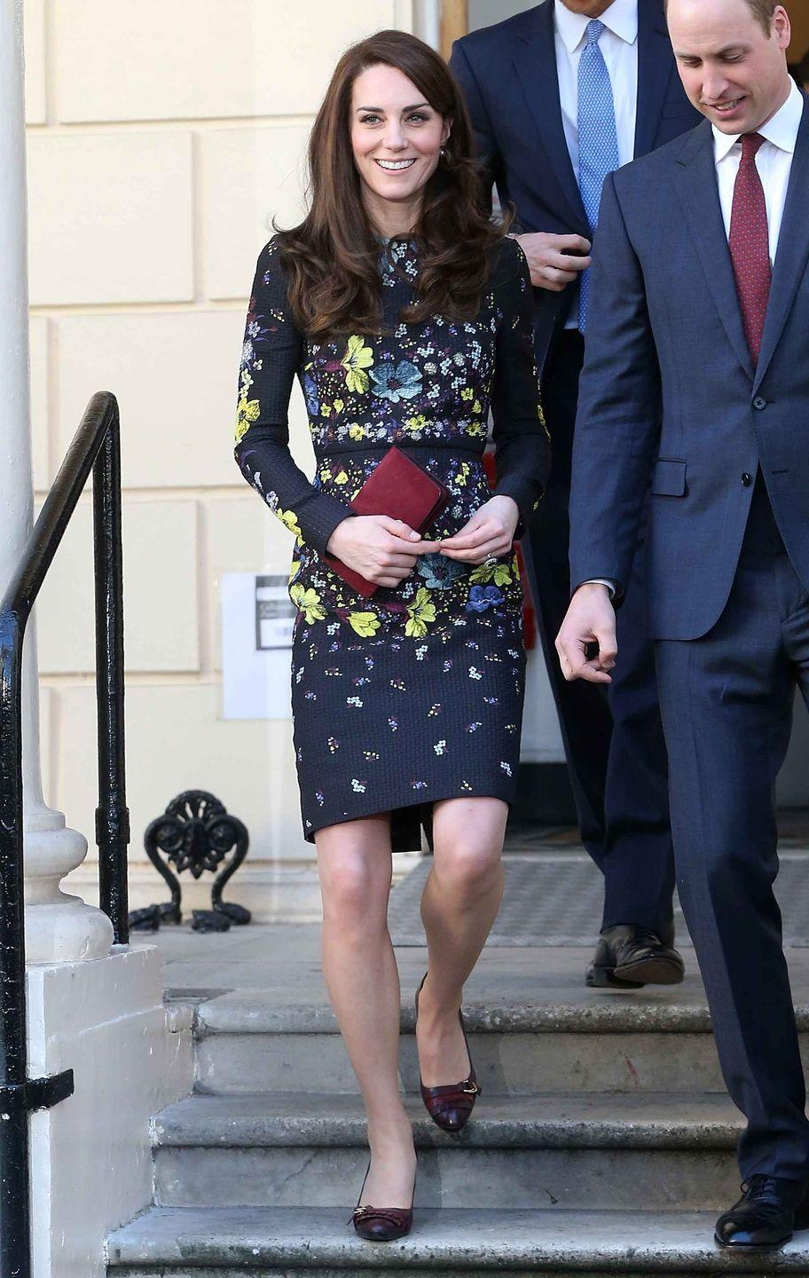 <p>Duchess Kate attends the Heads Together charity event with Prince William and Prince Harry. The Duchess wears a floral Erdem dress in a classic silhouette and paired the look with a Mulberry clutch and leather fringe pumps.</p>