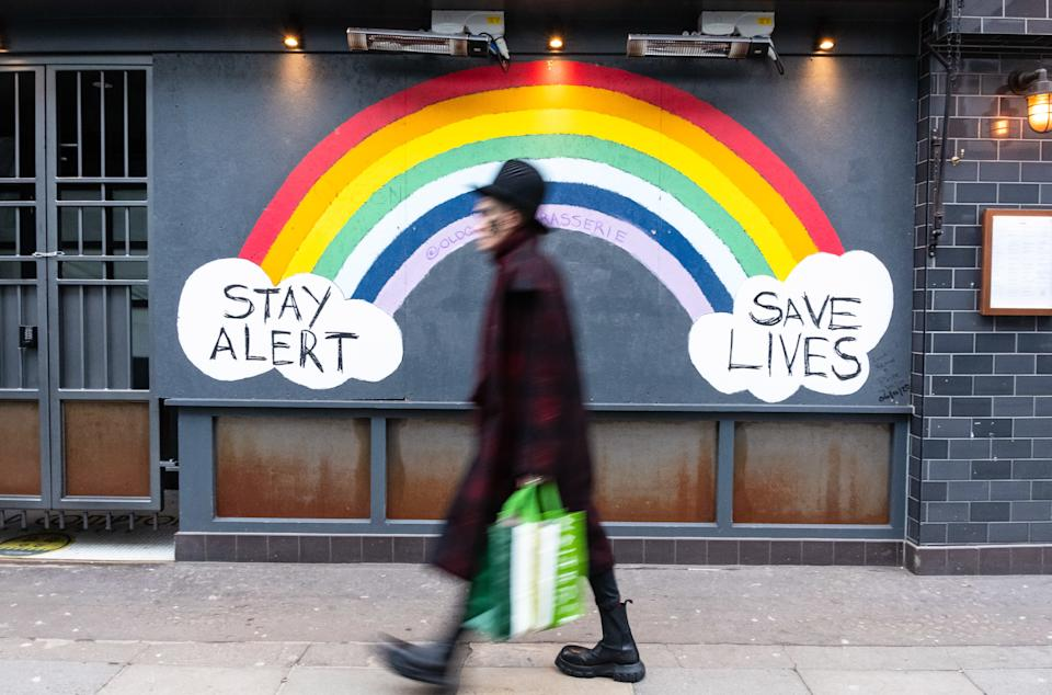 Pedestrian walks past a COVID-19 sign encouraging people to stay alert and save lives. Department of Health and Social Care recorded a total of 3,817,176 infections, 106,158 death and 1,673,936 recovered since the beginning of the outbreak. (Photo by May James / SOPA Images/Sipa USA)