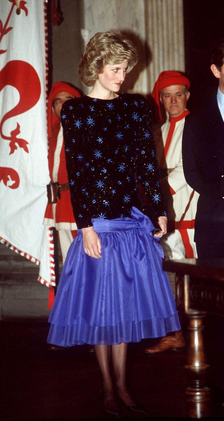 <p>In a blue-and-black dress by Jacques Azagury during the Royal Tour of Italy. </p>