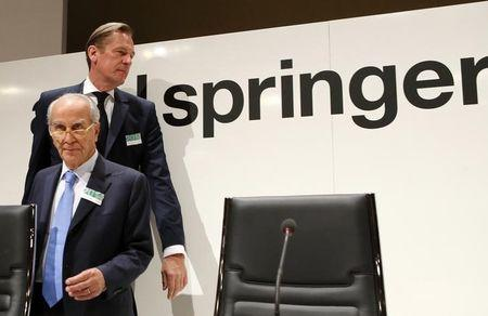 Mathias Doepfner (top), CEO of German publisher Axel Springer, and Giuseppe Vita, chairman of the supervisory board, arrive for the company's annual shareholders meeting in Berlin April 16, 2014.   REUTERS/Fabrizio Bensch/Files