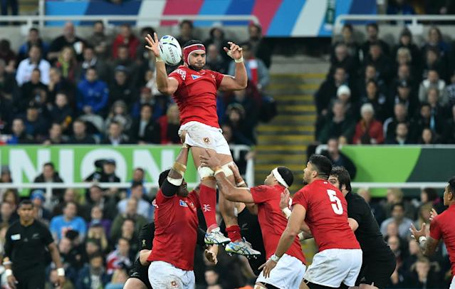 Tonga's flanker Sione Kalamafoni (C) jumps for the ball in a line out during a Pool C match of the 2015 Rugby World Cup between New Zealand and Tonga at St James' Park in Newcastle-upon-Tyne, northeast England, on October 9, 2015. AFP PHOTO / GABRIEL BOUYS RESTRICTED TO EDITORIAL USE, NO USE IN LIVE MATCH TRACKING SERVICES, TO BE USED AS NON-SEQUENTIAL STILLSTonga's flanker Sione Kalamafoni (C) jumps for the ball in a line out during a Pool C match of the 2015 Rugby World Cup between New Zealand and Tonga at St James' Park in Newcastle-upon-Tyne, northeast England, on October 9, 2015. AFP PHOTO / GABRIEL BOUYS RESTRICTED TO EDITORIAL USE, NO USE IN LIVE MATCH TRACKING SERVICES, TO BE USED AS NON-SEQUENTIAL STILLS (AFP Photo/GABRIEL BOUYS)