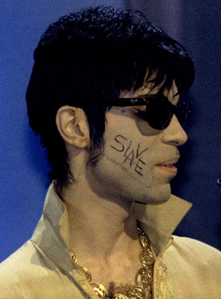 """The man formerly known as Prince, with the word """"Slave' written on his cheek, appears at the Brit Awards, the most prestigious event in UK pop music, on February 20, 1995. (Photo: Reuters)"""