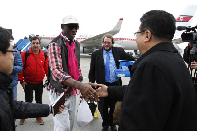 Former NBA basketball star Dennis Rodman shakes hands with North Korea's Sports Ministry Vice Minister Son Kwang Ho upon his arrival at the international airport in Pyongyang, North Korea, Monday, Jan. 6, 2014. Rodman took a team of former NBA players on a trip for an exhibition game on Kim Jong Un's birthday, Wednesday, Jan. 8. (AP Photo/Kim Kwang Hyon)