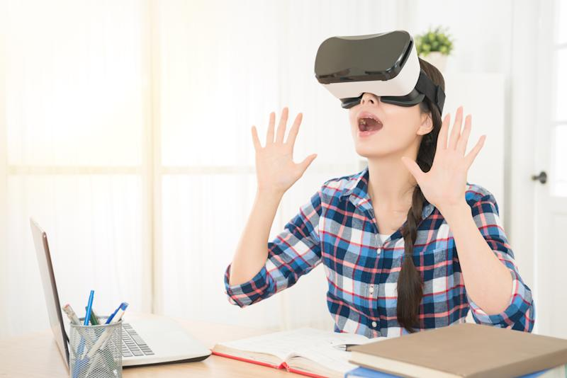 shocked woman enjoying virtual reality