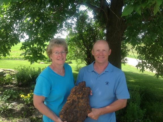 Farmers Bruce and Nelva Lilienthal proudly hold a meteorite they discovered in their Minnesota corn field.