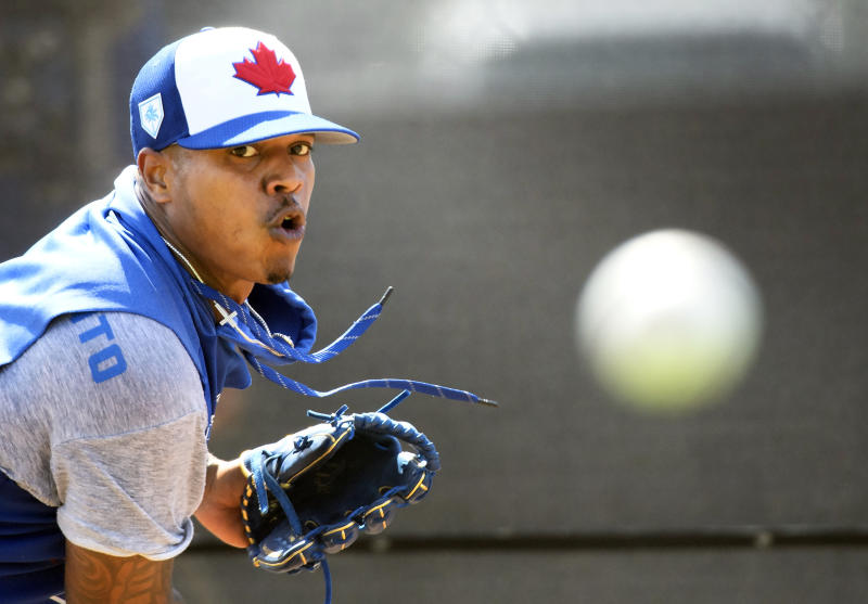 FILE - in this Feb. 16, 2019 file photo, Toronto Blue Jays pitcher Marcus Stroman throws a bullpen session at spring training baseball in Dunedin, Fla. Just two years removed from a second consecutive ALCS appearance, the Blue Jays have turned over the core of those postseason teams and started transitioning to the future. All over the diamond this season, young players will be given the opportunity to establish themselves.(Nathan Denette/The Canadian Press via AP)
