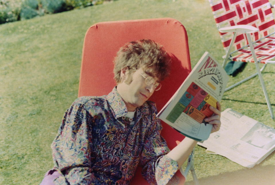 LONDON - 1st JANUARY: John Lennon (1940-1980) from the Beatles reads a magazine on a garden lounger in London, summer 1967. (Photo by Mark and Colleen Hayward/Redferns)