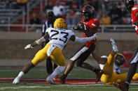 West Virginia's Tykee Smith (23) tackles Texas Tech's Myles Price (18) during the first half of an NCAA football game on Saturday, Oct. 24, 2020, in Lubbock, Texas. (AP Photo/Brad Tollefson)