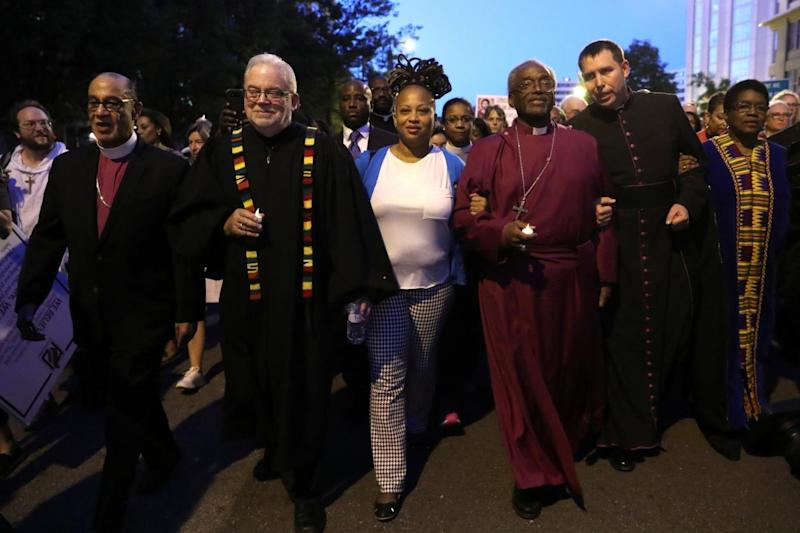 Bishop Curry leads fellow clergy on the march on the White House (REUTERS)