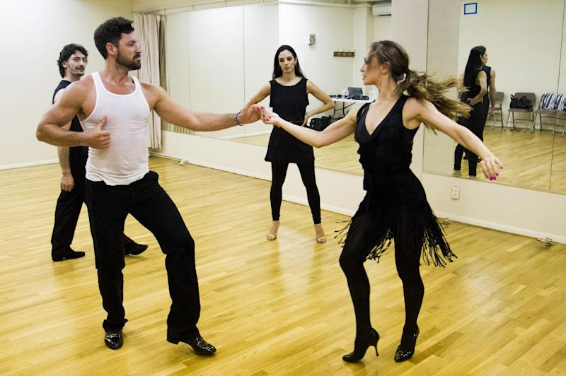 "FILE - In this June 28, 2013 photo, dancers Karina Smirnoff, right, and Maksim Chmerkovskiy rehearse for the upcoming Broadway show ""Forever Tango"" as Juan Horvath, background left, and Victoria Galoto, look on in New York. Smirnoff and Chmerkovskiy, best known for their work on ""Dancing with the Stars,"" will star in the revival of Luis Bravo's ""Forever Tango,"" which traces the dance's birth on the streets of 19th-century Buenos Aires to its more modern manifestations. (Photo by Charles Sykes/Invision/AP, File)"